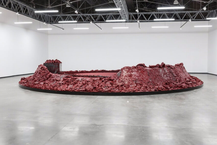 mirror by british indian artist Anish Kapoor on view in london and new york gallery