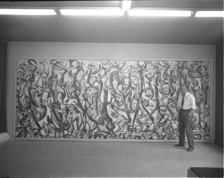Jackson Pollock standing in front of Mural